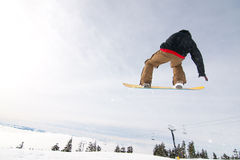 Male Snowboarder Catches Big Air. stock photos