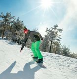Male snowboarder enjoys the ski resort. At mountain Stock Images