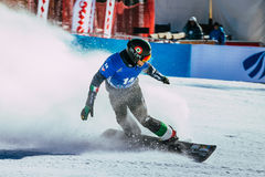 Male snowboarder finish line after race Stock Images