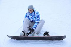 Male snowboarder on ski piste at snowy resort. Winter vacation Royalty Free Stock Photography