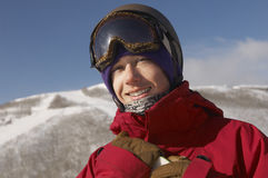 Male Snowboarder Smiling. Portrait of young male snowboarder smiling Royalty Free Stock Images
