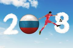 Male soccer player kicks a Russia soccer ball. With 2018 numbers Stock Photos