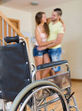 Male social worker assisting girl during rehabilitational  perio. D. Focus on wheelchair Stock Photography