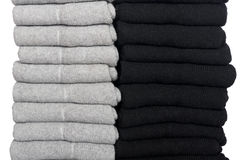 Male socks neatly folded in a pile. Isolated on a white Stock Photos