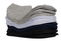 Male socks neatly folded in a pile. Isolated on a white Stock Photo
