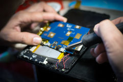 Male solder parts smartphone, repair. Close-up Stock Photo