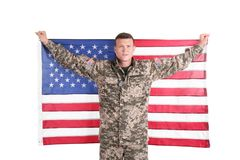 Male soldier with American flag royalty free stock photo