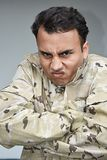 Male Soldier And Anger. A handsome adult hispanic male Royalty Free Stock Photos