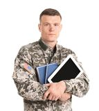 Male soldier with books and tablet computer. On white background. Military service Royalty Free Stock Photography