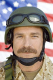 Male Soldier In Front Of US Flag. Closeup portrait of a soldier with moustache in front of United States flag Stock Photography