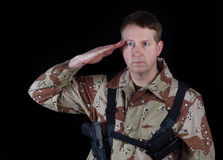 Male Soldier giving salute while under arms Stock Photos