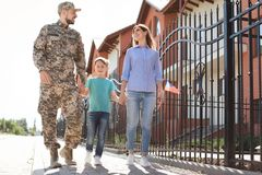 Male soldier with his family, outdoors. Military service. Male soldier with his family outdoors. Military service stock image