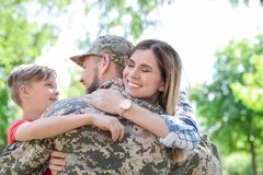 Male soldier with his family, outdoors. Military service. Male soldier with his family outdoors. Military service royalty free stock photos