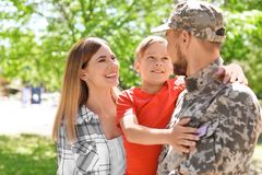 Male soldier with his family outdoors. Military service. Male soldier with his happy family outdoors. Military service royalty free stock photo