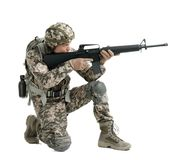 Male soldier with machine gun on white background. Military service Royalty Free Stock Image