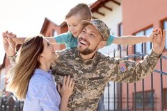 Male soldier reunited with his family, outdoors. Military service. Male soldier reunited with his family outdoors. Military service royalty free stock photo