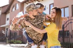 Male soldier reunited with his family, outdoors. Military service. Male soldier reunited with his family outdoors. Military service stock photos