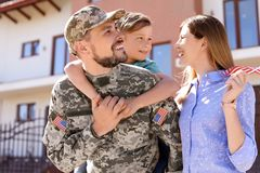 Male soldier reunited with his family, outdoors. Military service. Male soldier reunited with his family outdoors. Military service royalty free stock image