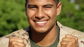 Male Soldier Smiling. A young hispanic male teen Stock Images
