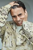 Male Soldier Under Stress. A handsome adult hispanic male Stock Images