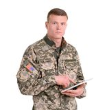 Male soldier using tablet computer on white background. Military service Royalty Free Stock Photo