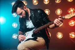 Male solo musican with electro guitar Stock Image