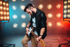 Male solo musican with electro guitar Stock Photo