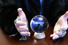 Divination by the crystal ball. Male sorcerer divination by the crystal ball Stock Images