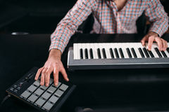 Male sound producer hands on musical keyboard. Male audio engineer hands on musical keyboard, closeup. Digital sound recording technology. Media engineering Stock Photos