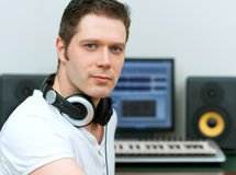 Male sound producer. Male sound producer in recording studio Stock Images