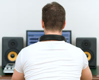 Male sound producer. Male sound producer in recording studio. Back view. Space for your text Royalty Free Stock Photos