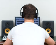 Male sound producer. Male sound producer in recording studio. Back view. Space for your text Stock Photography