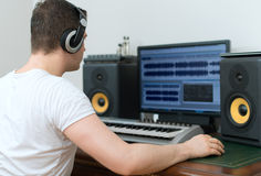 Male sound producer. Male sound producer working in recording studio Stock Image