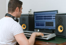 Male sound producer. Male sound producer working in recording studio Royalty Free Stock Image