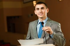 Male speaker. Looks into the room and said into the microphone, speech at the conference Royalty Free Stock Image