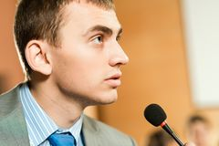 Male speaker. Looks into the room and said into the microphone, speech at the conference Stock Photography