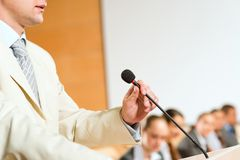 Male speaker. Looks into the room and said into the microphone, speech at the conference Royalty Free Stock Photos