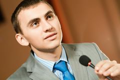 Male speaker. Looks into the room and said into the microphone, speech at the conference Stock Images