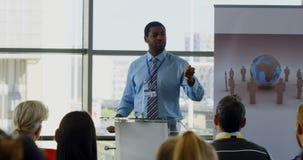 Male speaker speaking in a business seminar 4k. Front view of an African american male speaker speaking to the public in a business seminar 4k stock video