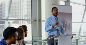 Male speaker speaking in a business seminar 4k. Side view of an African american male speaker speaking to the public in a business seminar 4k stock video footage
