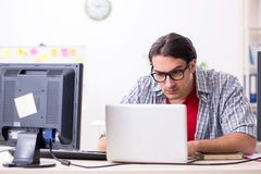 The male it specialist working in the office. Male it specialist working in the office royalty free stock image