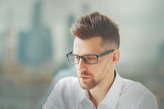 Male in spectacles. Close up portrait of handsome european male in spectacles on blurry city background Stock Photos