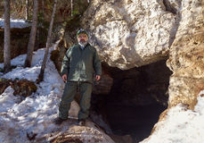 Male speleologist at the entrance to the cave. Arhangelsk region. Russia Royalty Free Stock Images