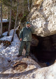 Male speleologist at the entrance to the cave. Arhangelsk region. Russia Royalty Free Stock Photography