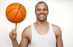 Basketball Spinning. Male spinning a basketball on his finger Royalty Free Stock Photos