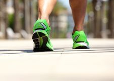 Male in sport shoe walking outside. Low angle male in sport shoe walking outside Royalty Free Stock Photography