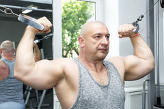 Male sports bodybuilding. Adult brutal man is engaged in sports bodybuilding Stock Photo