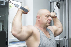 Male sports bodybuilding competitio. Adult brutal man is engaged in sports bodybuilding Royalty Free Stock Photography