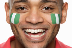 Male Sports Fan With Nigerian Flag Painted O. Young Male Sports Fan With Nigerian Flag Painted On Face Royalty Free Stock Photo
