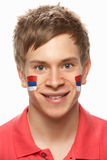 Male Sports Fan With Serbian Flag On. Young Male Sports Fan With Serbian Flag Painted On Face Royalty Free Stock Photo